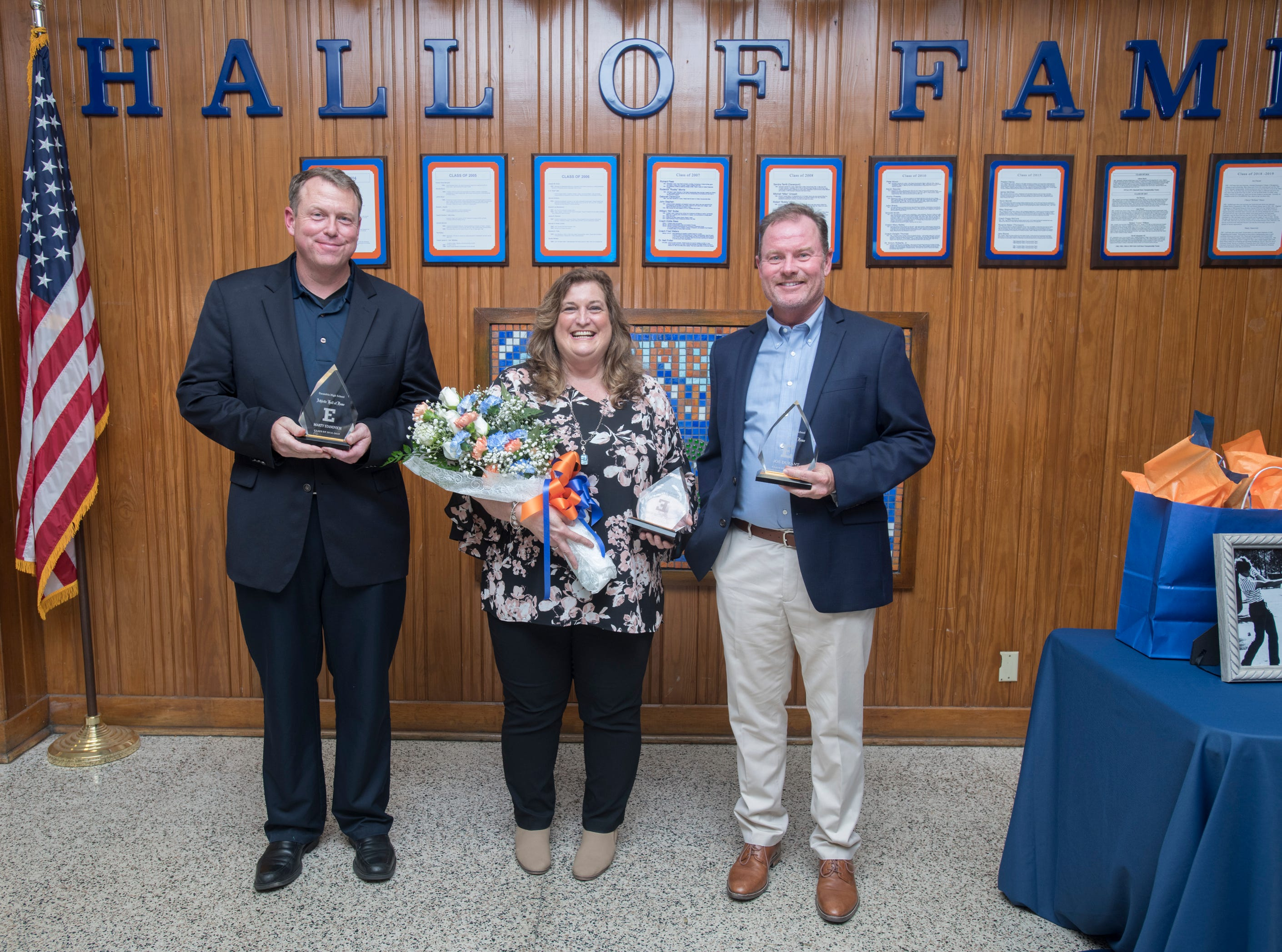 Hall of Fame class of 2018-2019 inductees Marty Stanovich, from left, Cheryl Peters, and Joe Durant  pose at Escambia High School in Pensacola on March 14, 2019.
