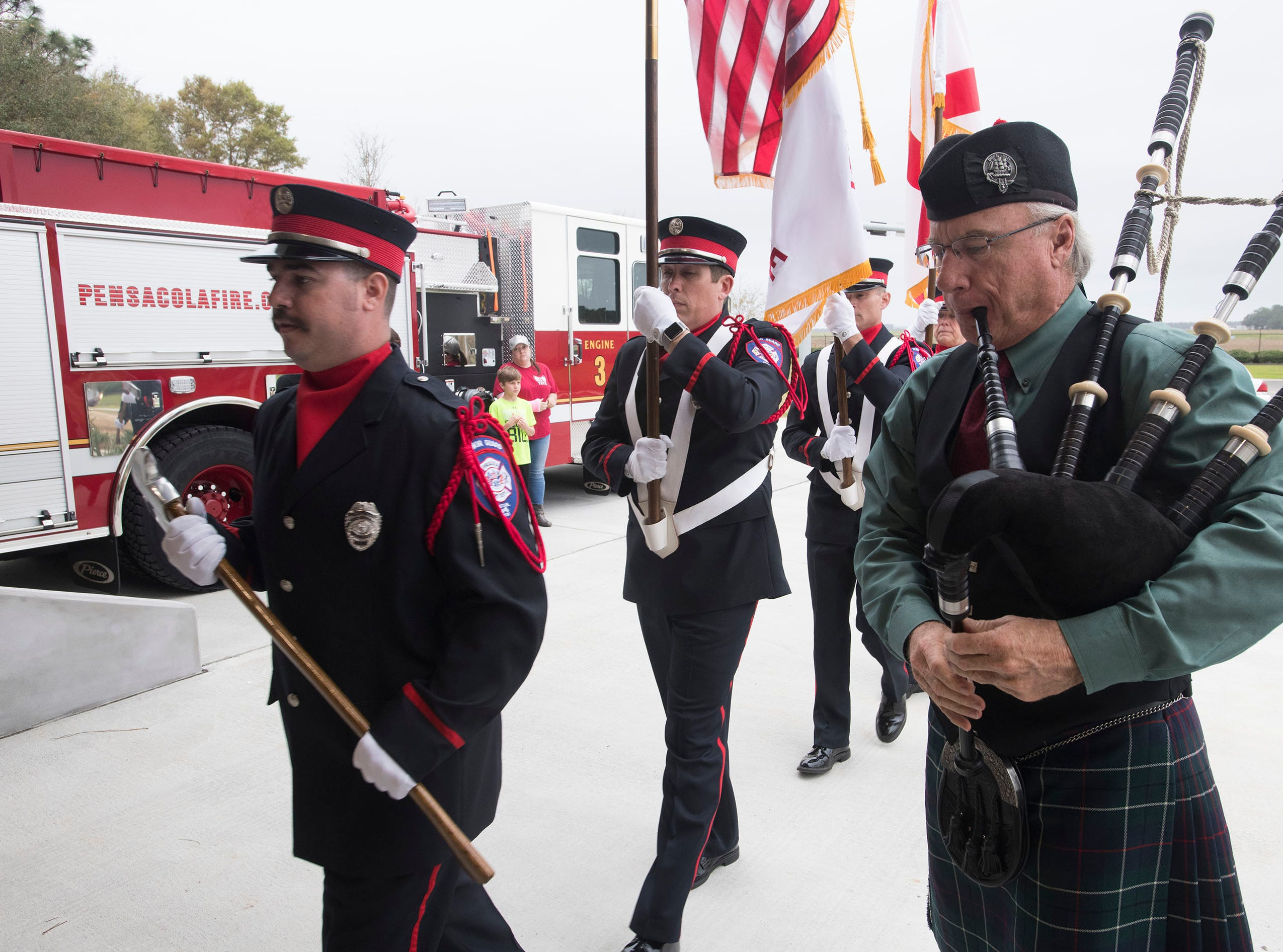 Michael Duncan plays the bagpipes as members of the Pensacola Fire Department's honor guard parades the colors to kick off the dedication ceremony of the department's new station three off Summit Blvd on Thursday, March 14, 2019.
