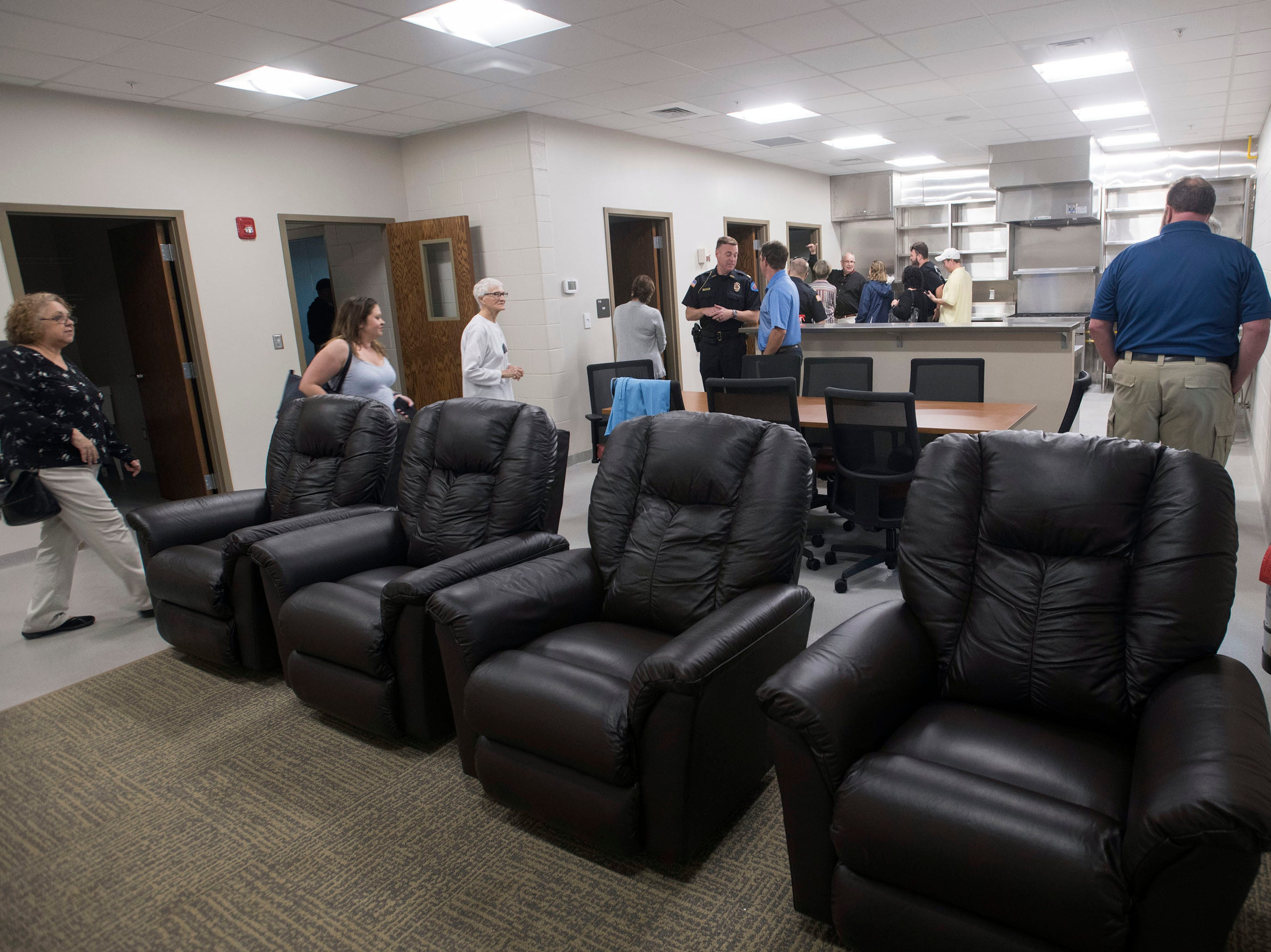 Visitors get a look at the shared living spaces at the new Pensacola Fire Sation Three off Summit Blvd on Thursday, March 14, 2019. The City of Pensacola dedicated the new facility and held an open house of the firehouse during the hour-long ceremony Thursday.