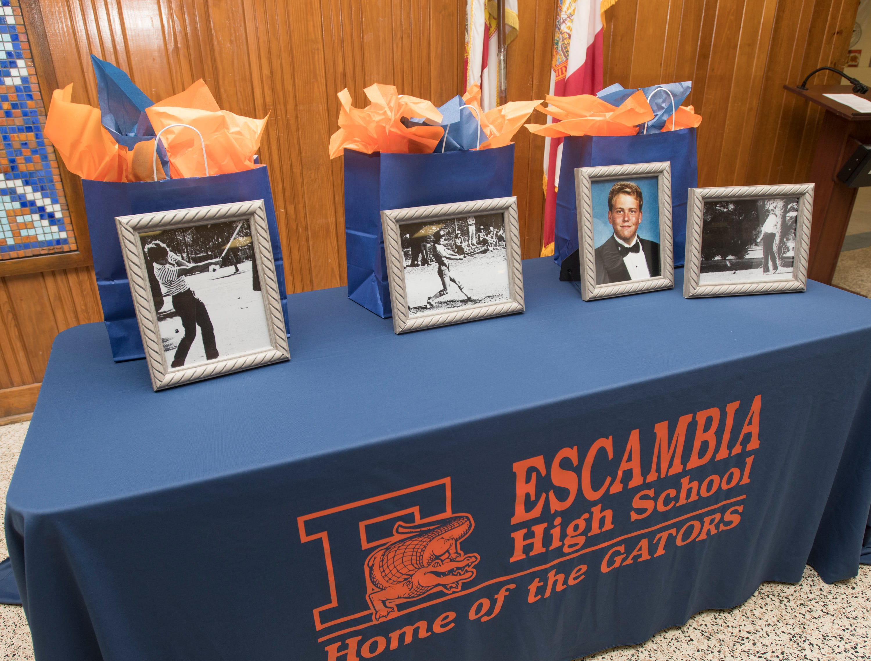 High school photos of Hall of Fame class of 2018-2019 inductees Joe Durant, from left, Cheryl Peters, and Marty Stanovich are displayed at Escambia High School in Pensacola on March 14, 2019.