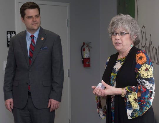 Cindy Roberts, executive director of the Life Options Clinic in Milton, describes the organization's mission Friday as U.S. Rep. Matt Gaetz, R-Fla., looks on, during the dedication of the organization's new building.