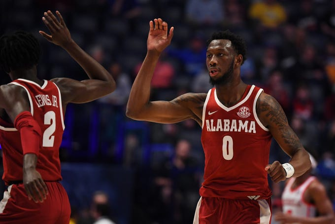 Mar 14, 2019; Nashville, TN, USA; Alabama Crimson Tide forward Donta Hall (0) is congratulated by Alabama Crimson Tide guard Kira Lewis Jr. (2) after a basket during the first half against the Mississippi Rebels of the SEC conference tournament at Bridgestone Arena. Mandatory Credit: Christopher Hanewinckel-USA TODAY Sports