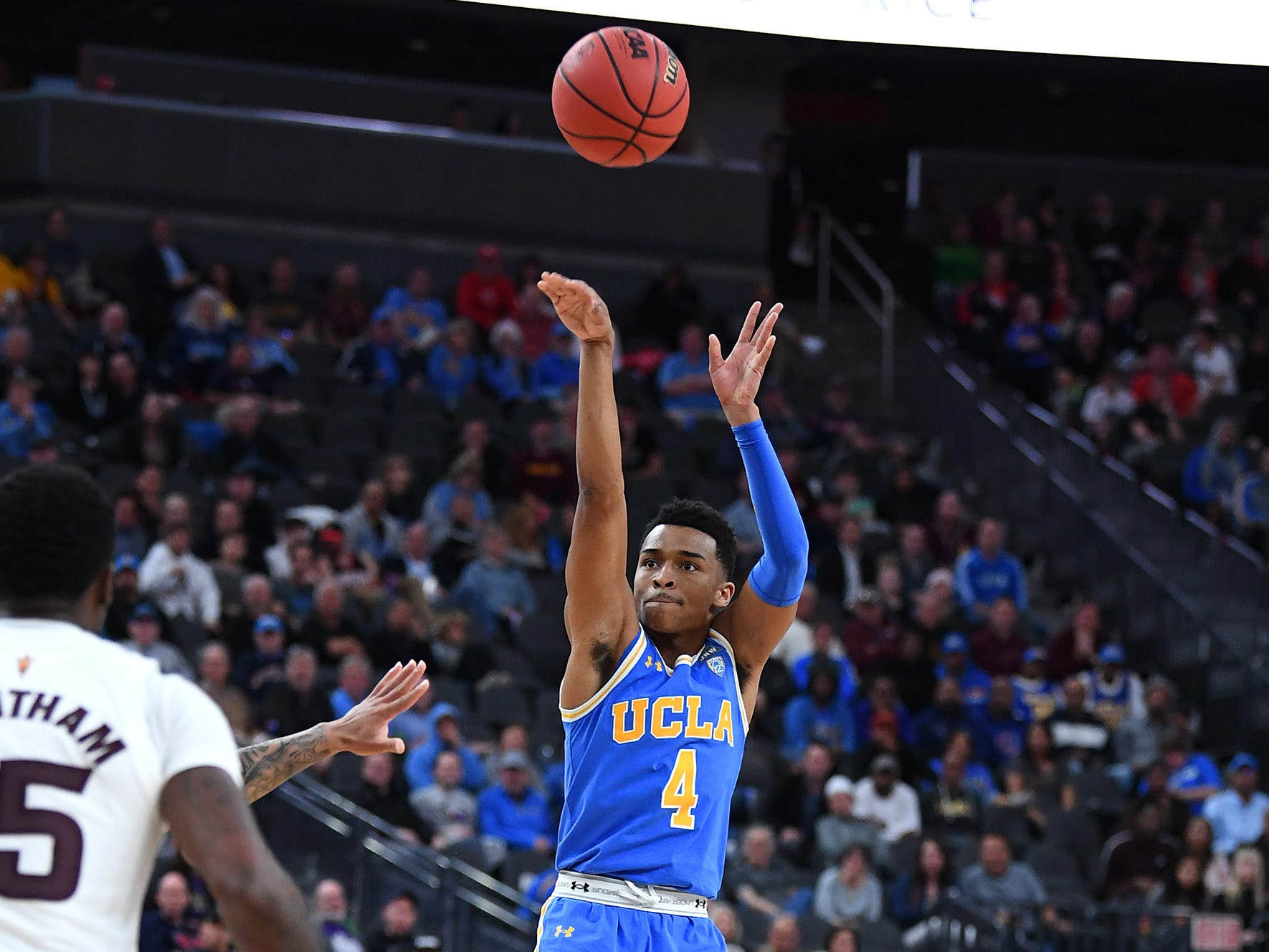 Mar 14, 2019; Las Vegas, NV, United States;UCLA Bruins guard Jaylen Hands (4) shoots during the second half of a Pac-12 conference tournament game against the Arizona State Sun Devils at T-Mobile Arena.