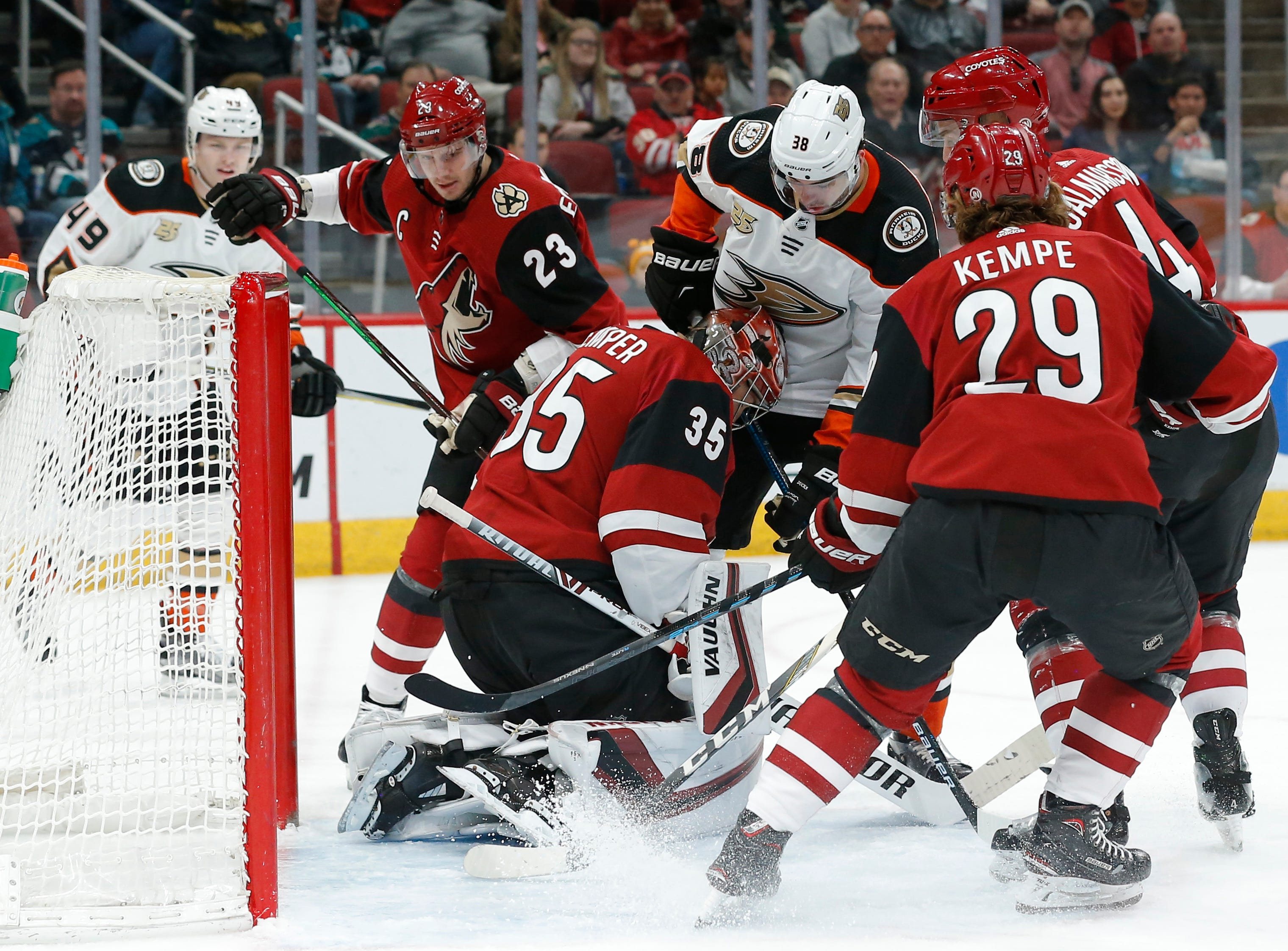 Anaheim Ducks center Derek Grant (38) tries to score against Arizona Coyotes goaltender Darcy Kuemper (35) in the first period during an NHL hockey game, Thursday, March 14, 2019, in Glendale, Ariz.