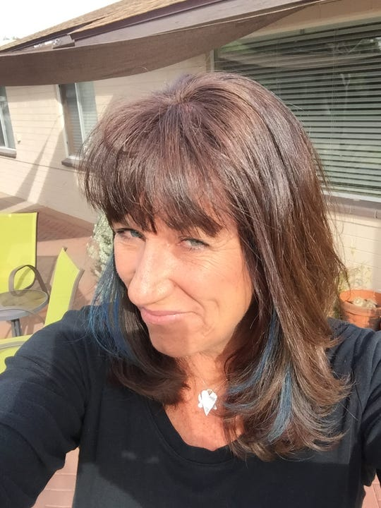When I turned 51, had blue streaks put in my hair. I had read about how women often feel that they become invisible at about my age. One study put it at exactly 51. Maybe the blue streaks would stir things up.