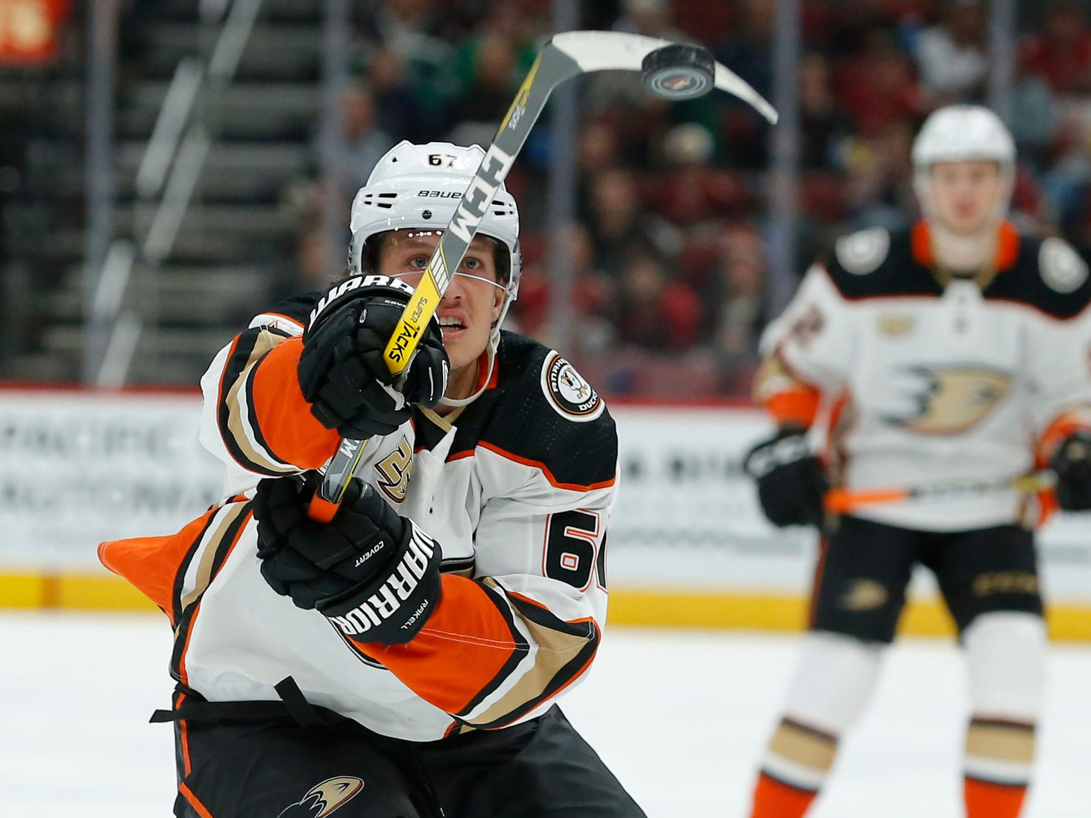 Anaheim Ducks left wing Rickard Rakell (67) swipes at the puck in the second period during an NHL hockey game against the Arizona Coyotes, Thursday, March 14, 2019, in Glendale, Ariz.