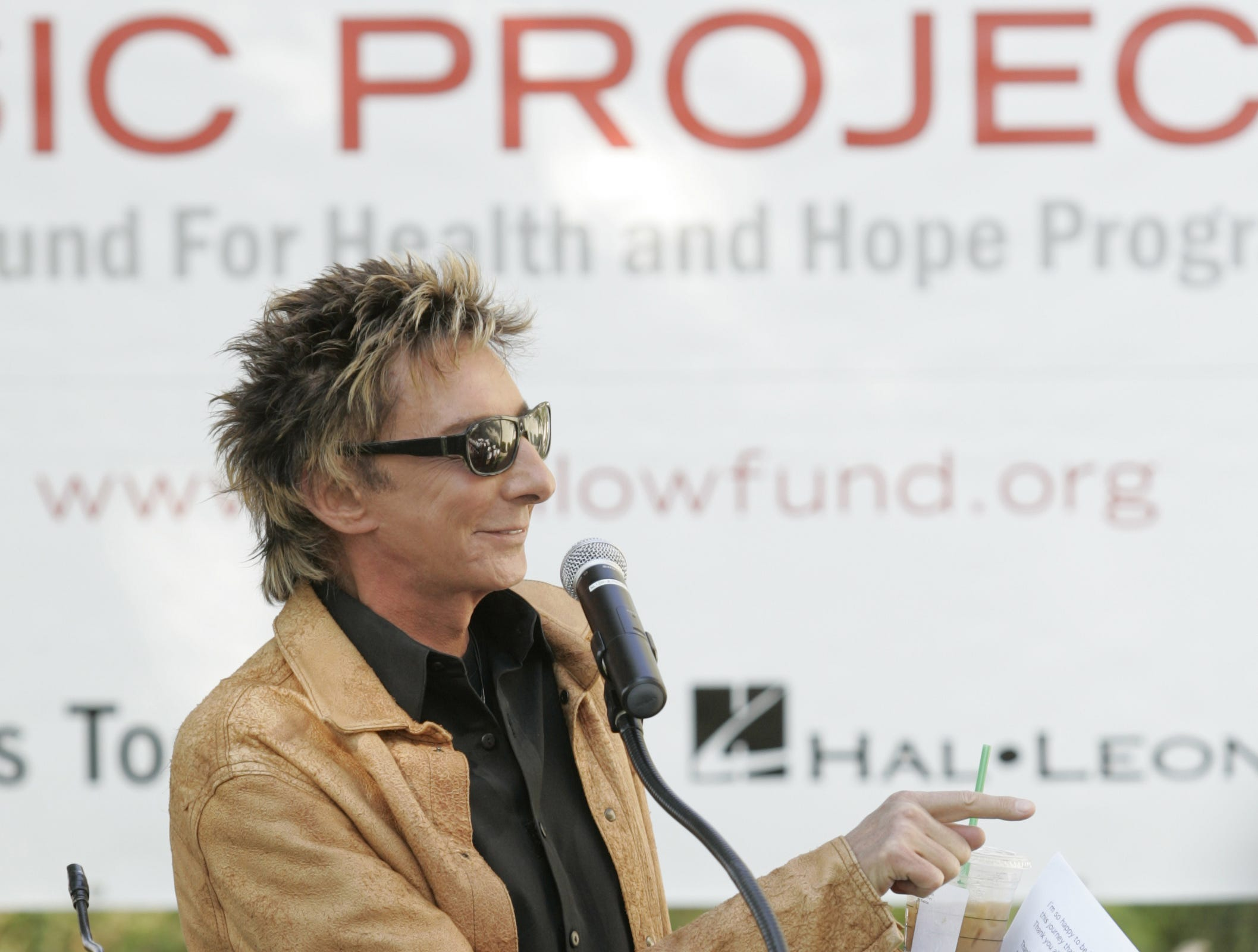 Barry Manilow praises the Palm Springs High School Jazz Band during the announcement of a $500,000 donation of instruments and musical supplies to 20 Coachella Valley schools on Sept. 29, 2008, at Palm Springs High School.