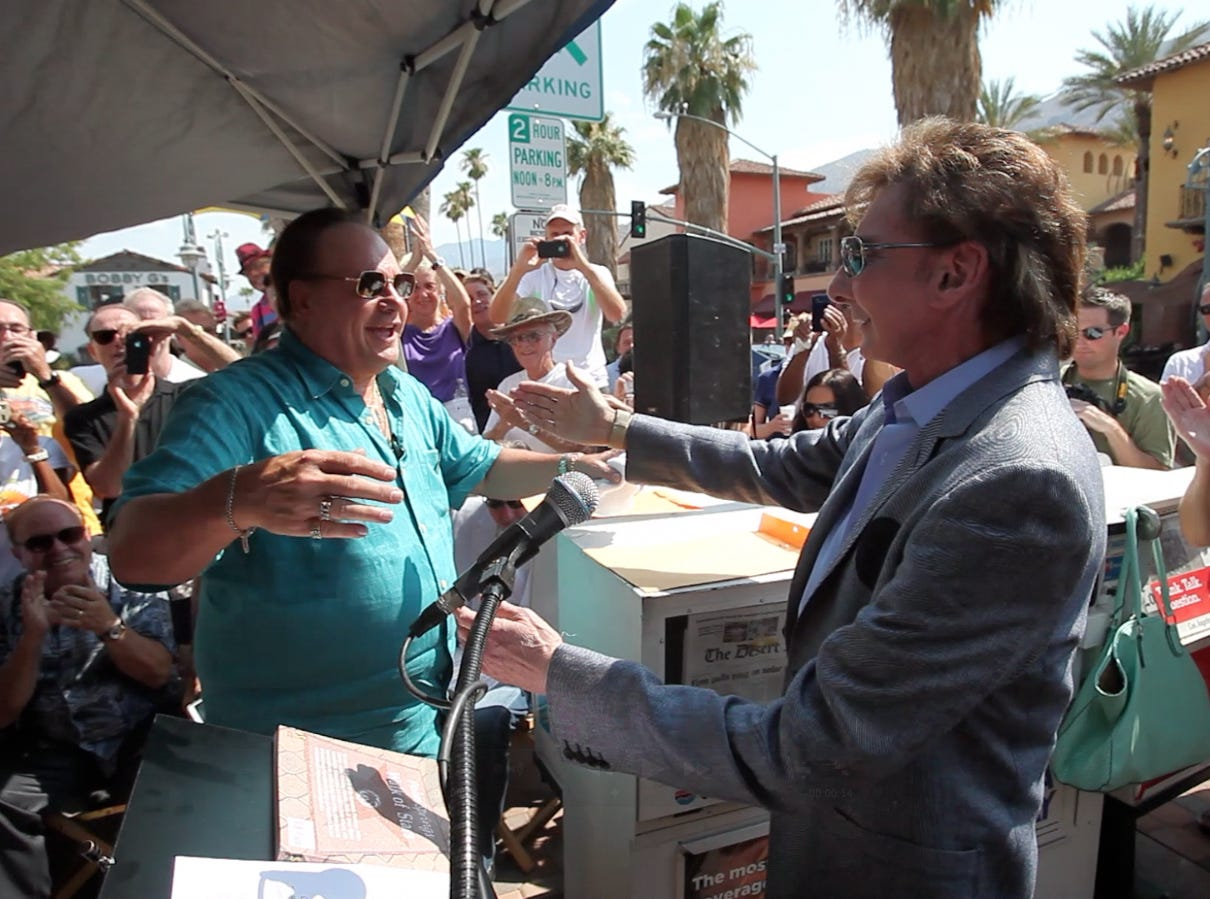 Barry Manilow hugs Harry Wayne Casey, the lead singer for KC and the Sunshine Band, during a Palm Springs Walk of Stars star unveiling ceremony for KC and the Sunshine Band on  July 6, 2013.  (Richard Lui The Desert Sun)