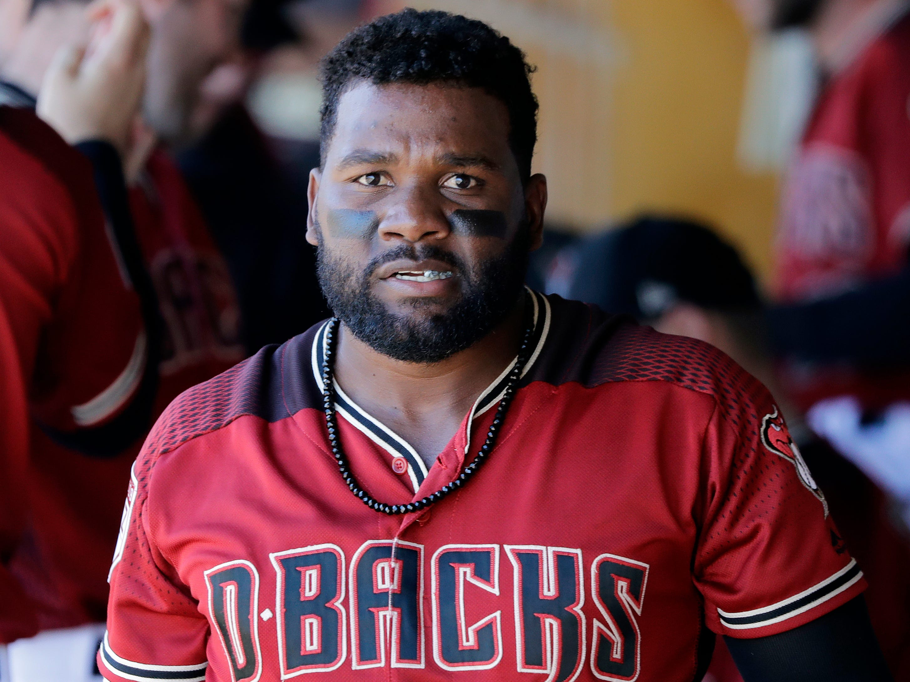 Arizona Diamondbacks' Abraham Almonte walks in the dugout during a spring training baseball game Thursday, March 14, 2019, in Scottsdale, Ariz.