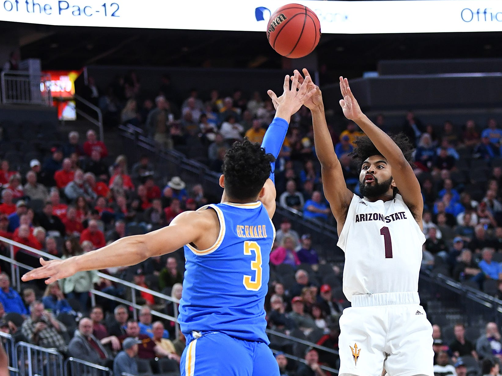 Mar 14, 2019; Las Vegas, NV, United States; Arizona State Sun Devils guard Remy Martin (1) shoots against UCLA Bruins guard Jules Bernard (3) during the first half of a Pac-12 conference tournament game at T-Mobile Arena.