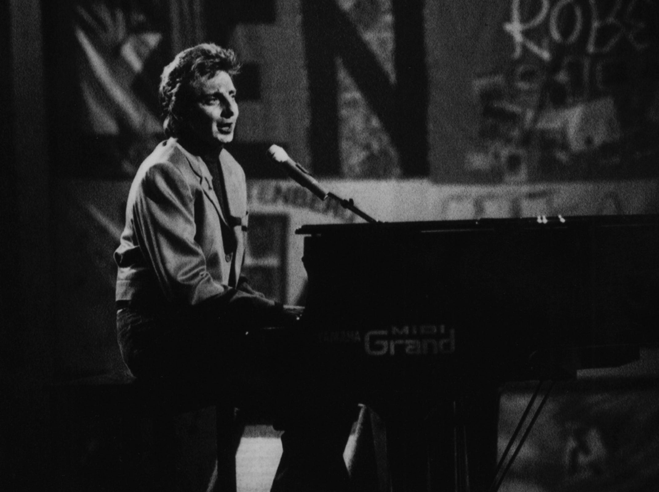 "Barry Manilow participates in the 1993 TV special ""In a New Light '93."" Arsenio Hall and Paula Abdula served as hosts."