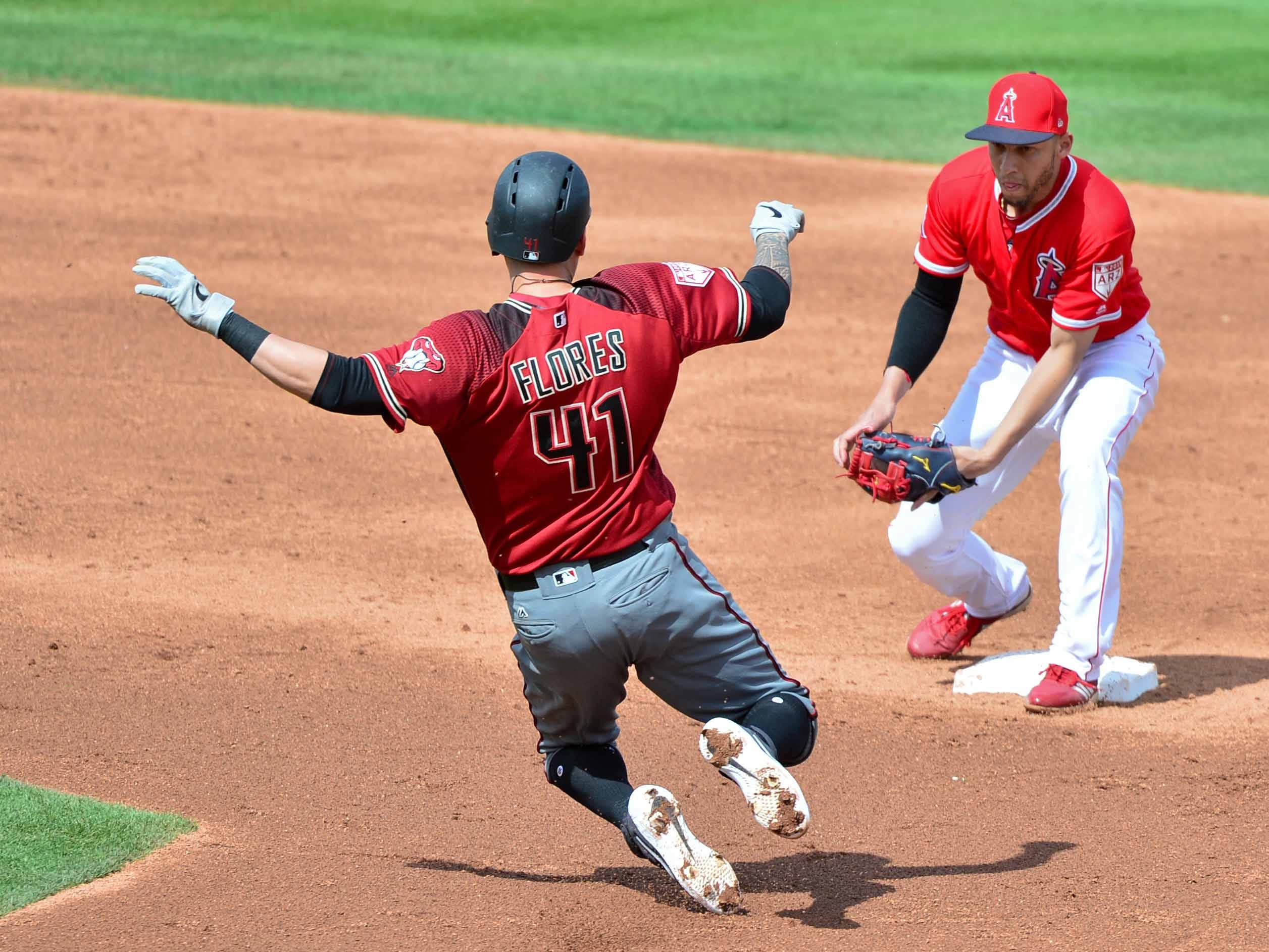 Mar 15, 2019; Tempe, AZ, USA; Arizona Diamondbacks third baseman Wilmer Flores (41) is out by Los Angeles Angels shortstop Andrelton Simmons (2) while stealing second base during the third inning at Tempe Diablo Stadium. Mandatory Credit: Matt Kartozian-USA TODAY Sports