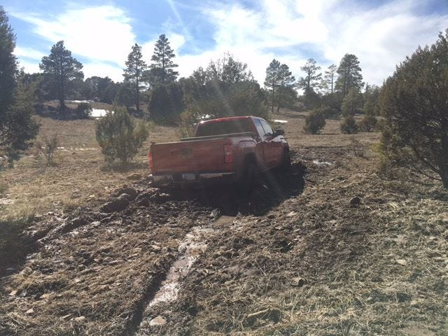The missing truck was found stuck in mud.