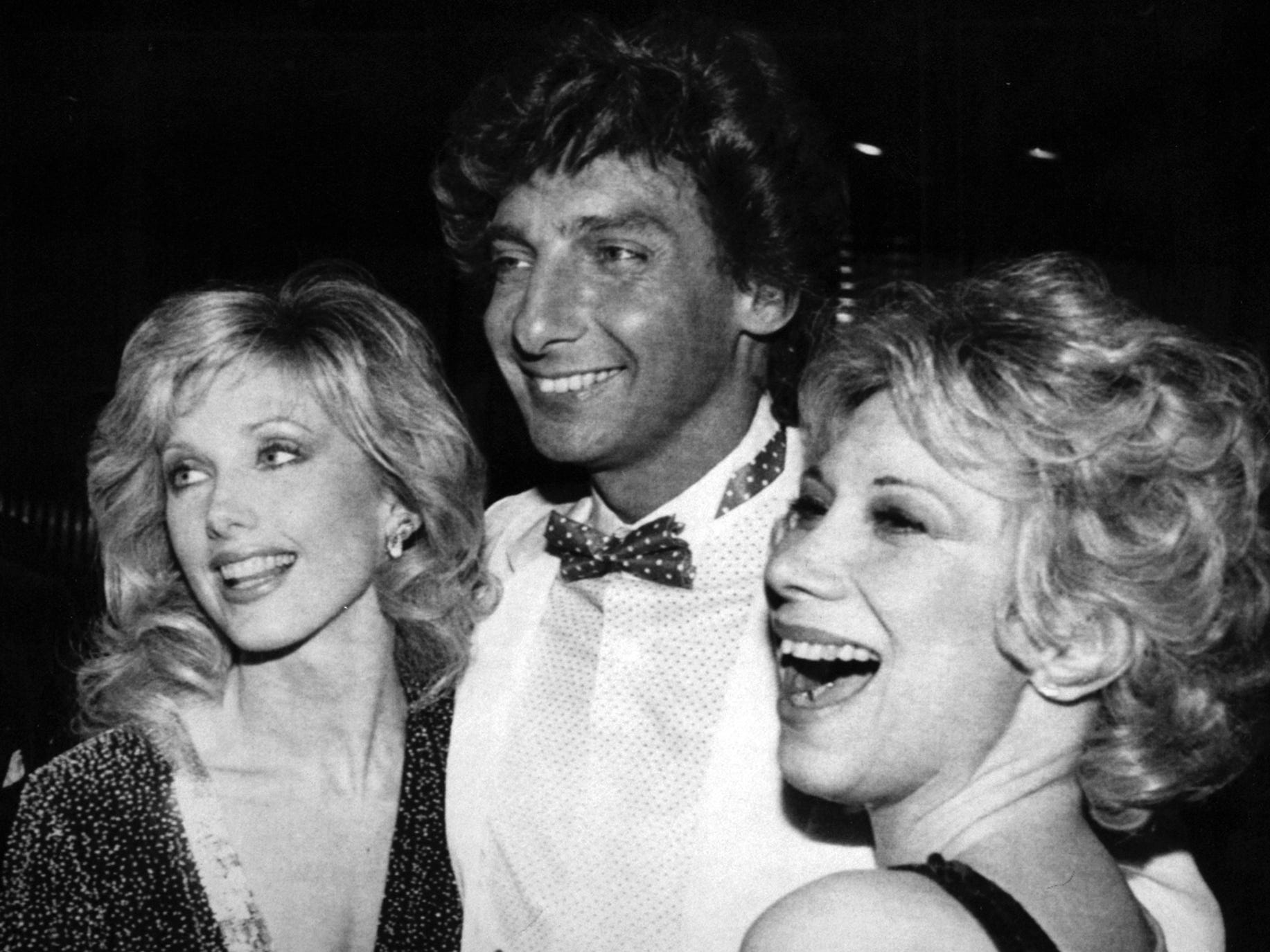 Actress Morgan Fairchild (left) and comedian Marilyn Michaels congratulate Barry Manilow after record-breaking Broadway opening in 1983.