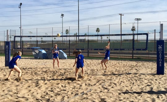 Xavier beach volleyball teammates (left to right) Trinity Cavanaugh (1), Abby Converse, Serena Turner (12), and Shannon Shields 9 practice for their match against Tempe Corona del Sol, on March 1, 2019.