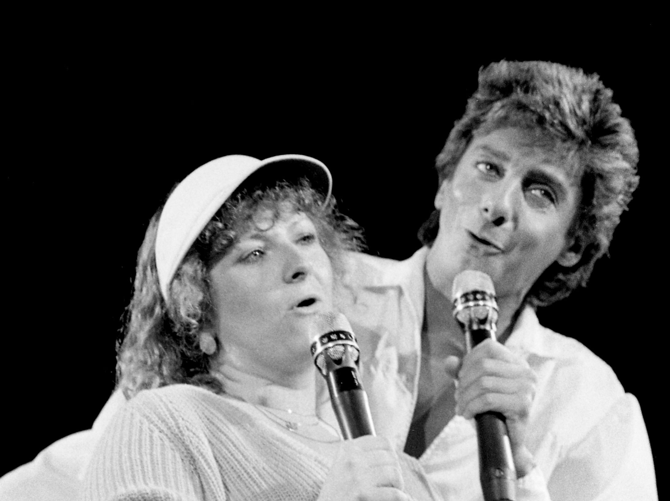 "Barry Manilow, performs ""Can't Smile Without You"" with Indiana University senior Karen Volk during his Nashville concert on Nov. 14, 1985."