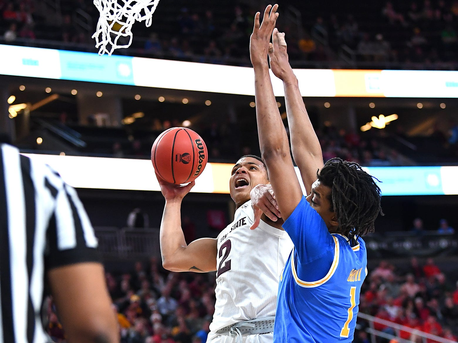 Mar 14, 2019; Las Vegas, NV, United States; Arizona State Sun Devils guard Rob Edwards (2) shoots as UCLA Bruins center Moses Brown (1) defends during the first half of a Pac-12 conference tournament game at T-Mobile Arena.