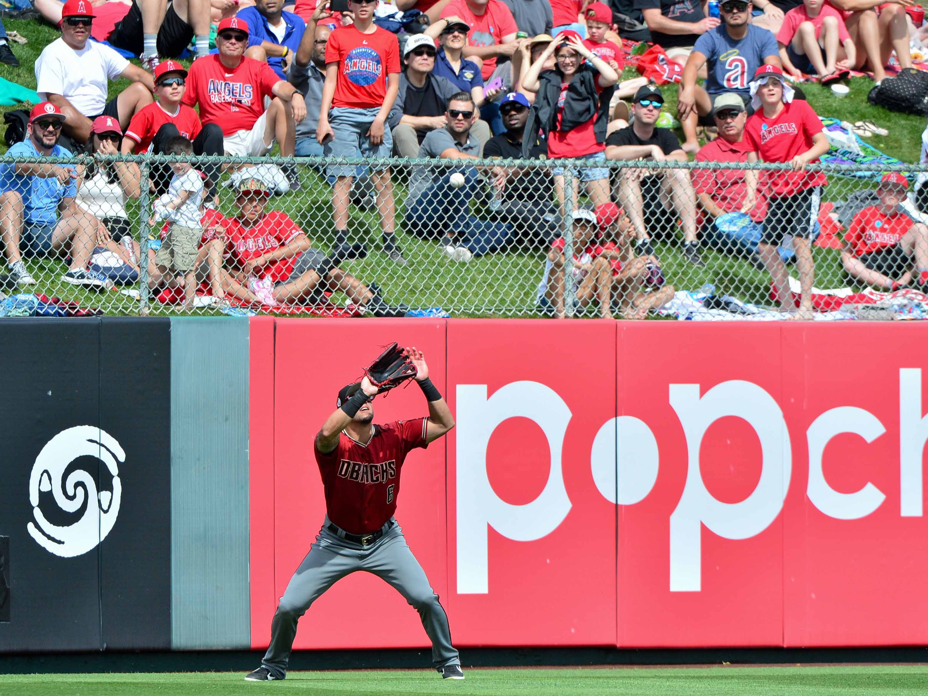 Mar 15, 2019; Tempe, AZ, USA; Arizona Diamondbacks catcher Matt Jones (6) catches a fly ball to end the second inning against the Los Angeles Angels at Tempe Diablo Stadium. Mandatory Credit: Matt Kartozian-USA TODAY Sports