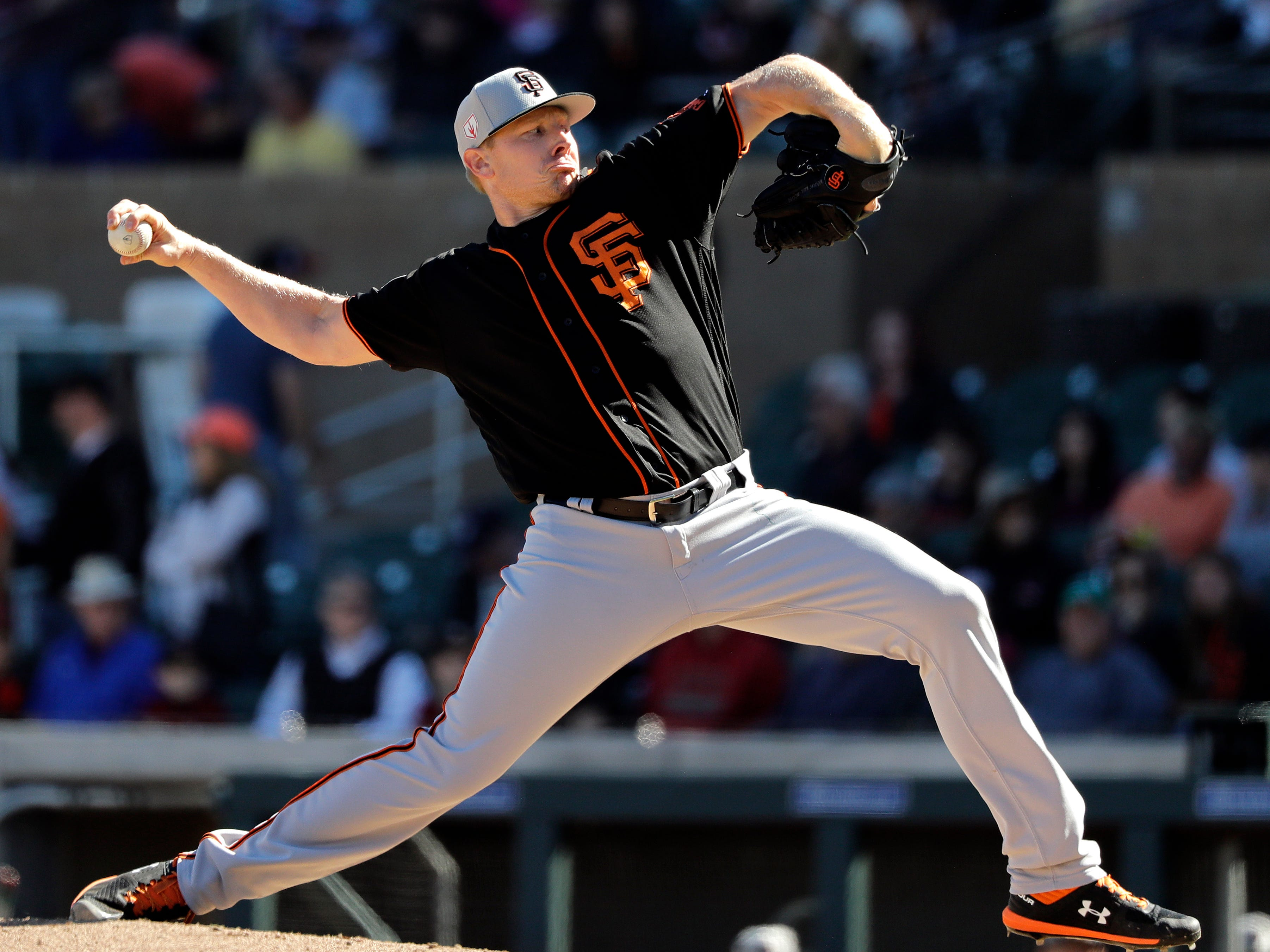 San Francisco Giants relief pitcher Mark Melancon throws to an Arizona Diamondbacks batter during the seventh inning of a spring training baseball game Thursday, March 14, 2019, in Scottsdale, Ariz.