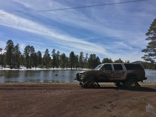 The Coconino County Sheriff's Office used vehicles outfitted with special tracks for snow and mud.
