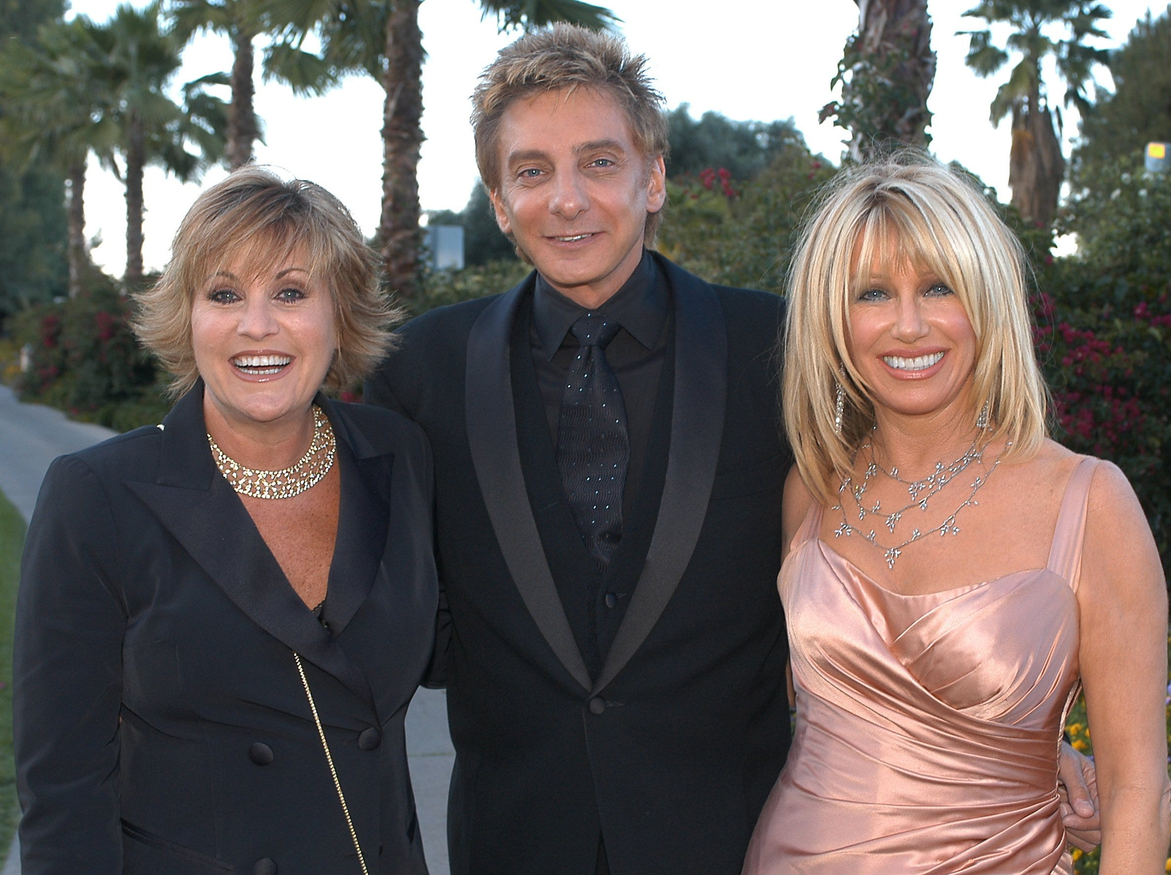 Lorna Luft (left), Barry Manilow and Suzanne Somers arrive at the Aids Assistance Program's Evening Under the Stars in 2003 in Palm Springs, California.
