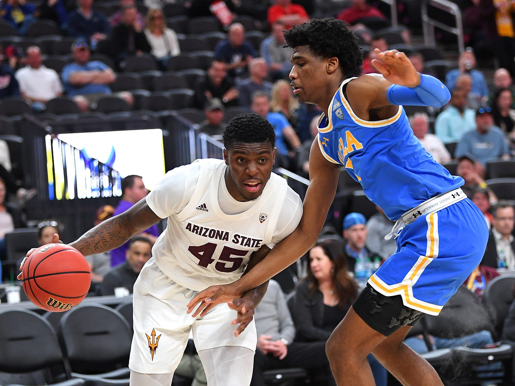 Mar 14, 2019; Las Vegas, NV, United States; Arizona State Sun Devils forward Zylan Cheatham (45) dribbles against UCLA Bruins guard Chris Smith (5) during the first half of a Pac-12 conference tournament game at T-Mobile Arena.