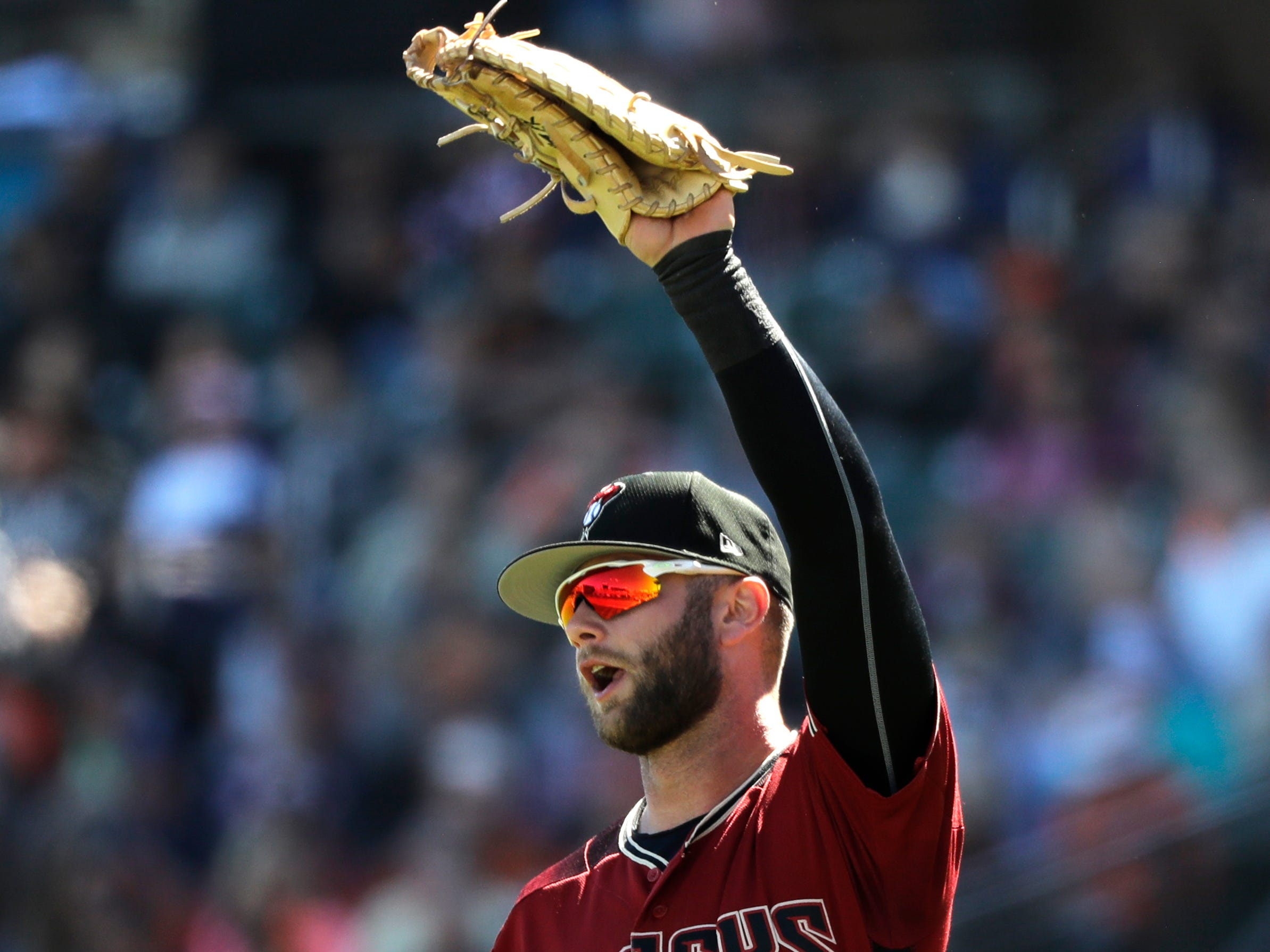 Arizona Diamondbacks first baseman Christian Walker in action against the San Francisco Giants in a spring training baseball game Thursday, March 14, 2019, in Scottsdale, Ariz.