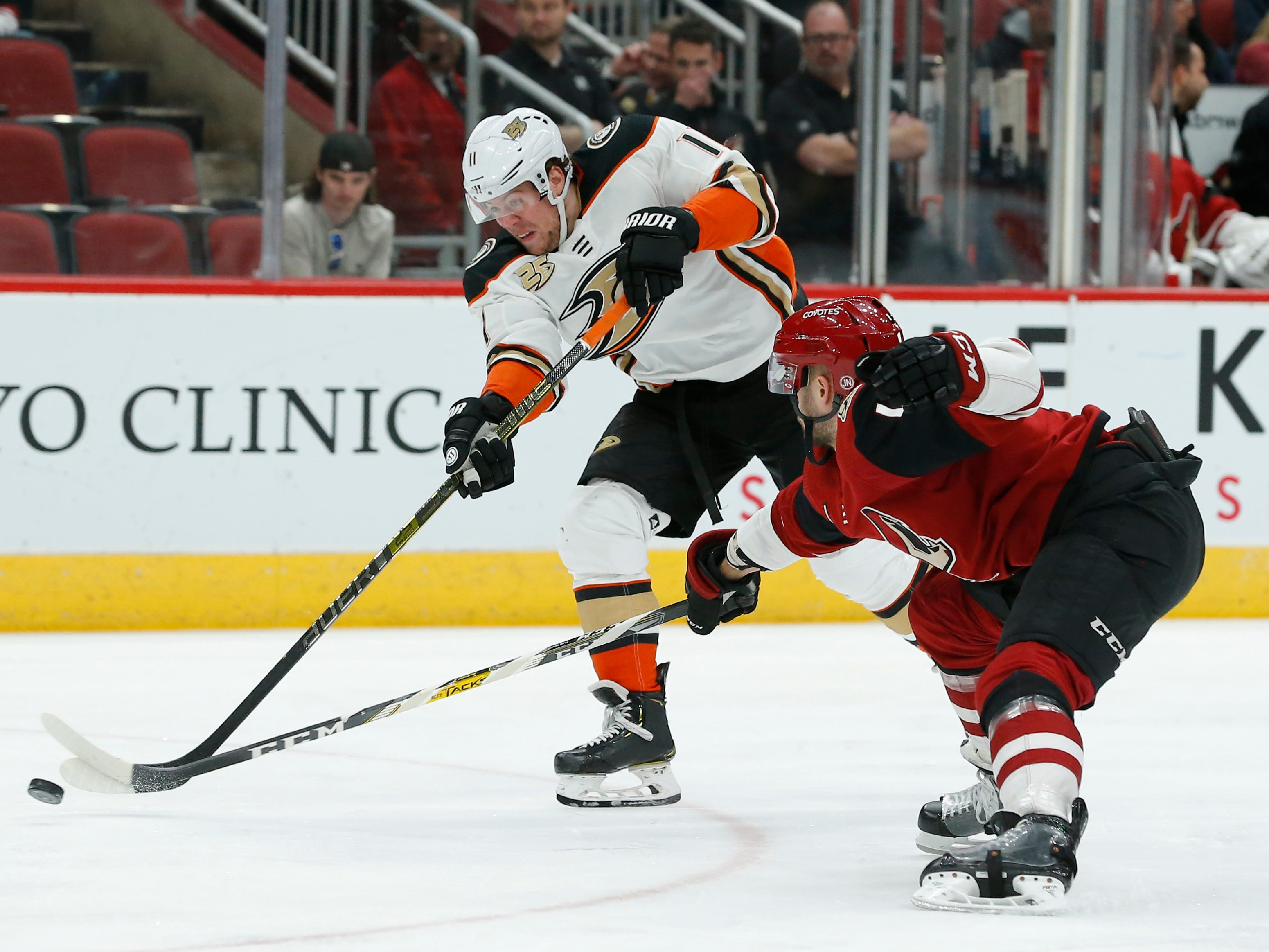 Anaheim Ducks right wing Daniel Sprong (11) shoots in front of Arizona Coyotes defenseman Niklas Hjalmarsson in the first period during an NHL hockey game, Thursday, March 14, 2019, in Glendale, Ariz.