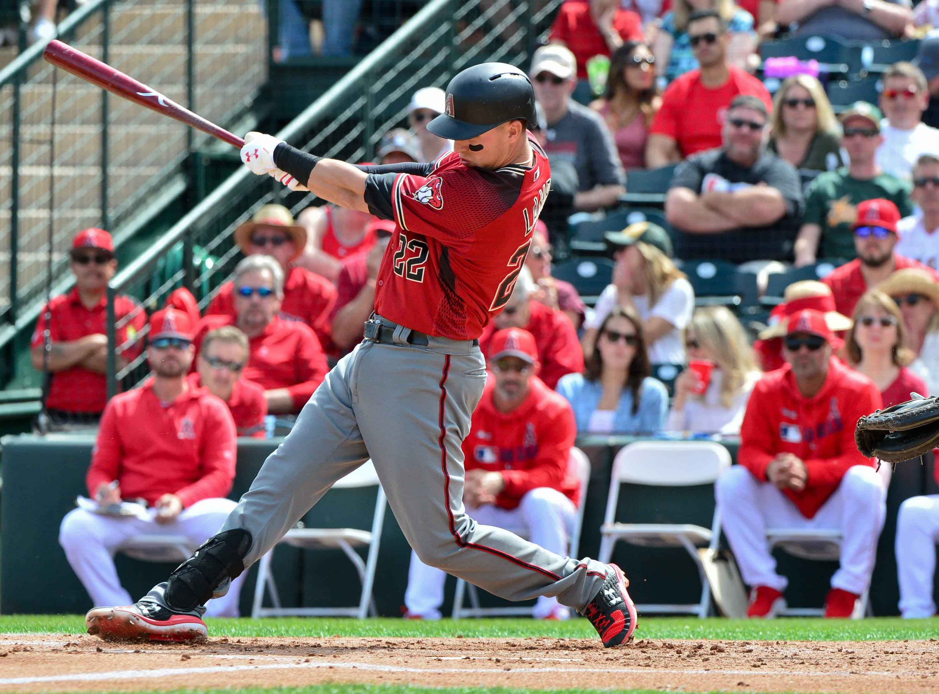 Mar 15, 2019; Tempe, AZ, USA; Arizona Diamondbacks third baseman Jake Lamb (22) grounds out in the second inning against the Los Angeles Angels at Tempe Diablo Stadium. Mandatory Credit: Matt Kartozian-USA TODAY Sports