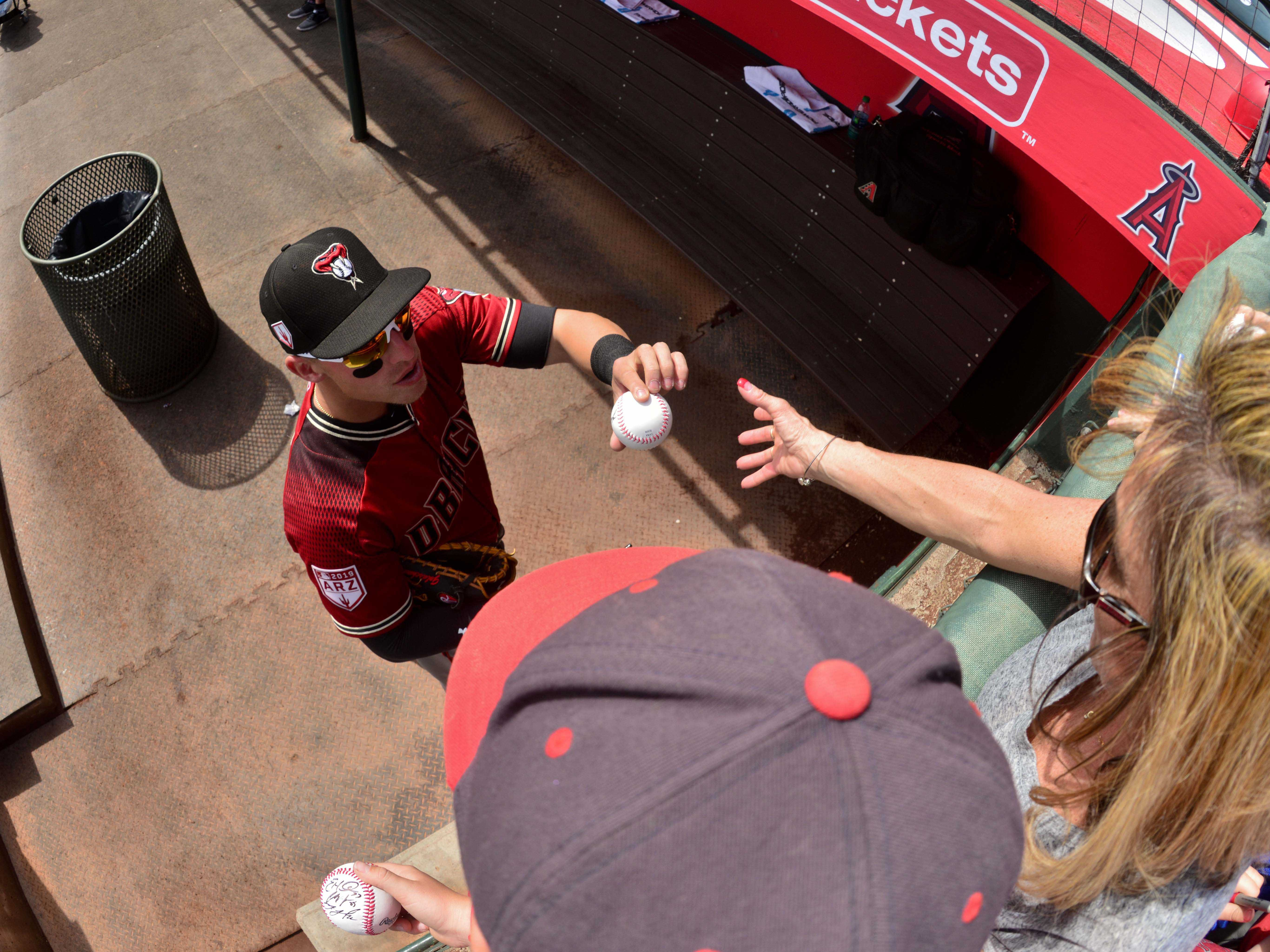 Mar 15, 2019; Tempe, AZ, USA; Arizona Diamondbacks third baseman Jake Lamb (22) signs autographs for fans prior to the game against the Los Angeles Angels at Tempe Diablo Stadium. Mandatory Credit: Matt Kartozian-USA TODAY Sports