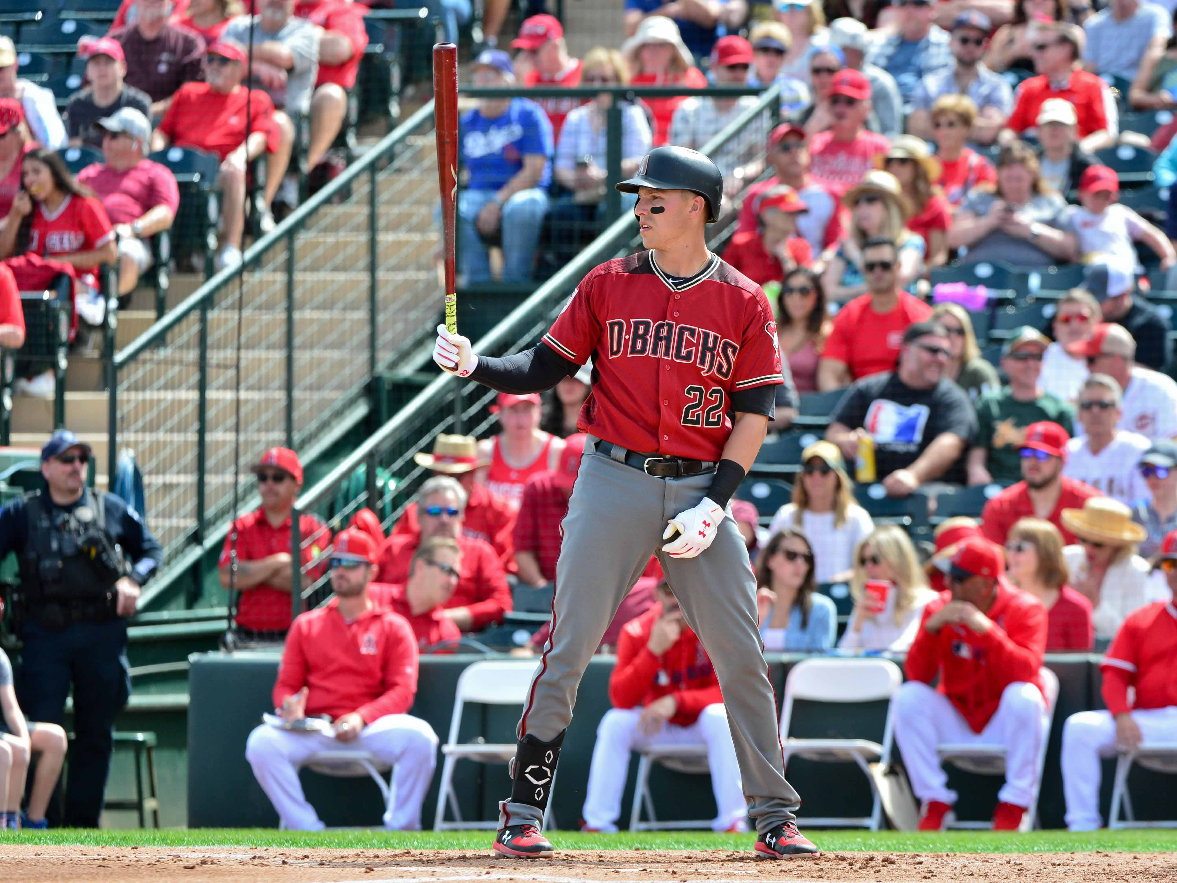 Mar 15, 2019; Tempe, AZ, USA; Arizona Diamondbacks third baseman Jake Lamb (22) at bat in the second inning against the Los Angeles Angels at Tempe Diablo Stadium. Mandatory Credit: Matt Kartozian-USA TODAY Sports