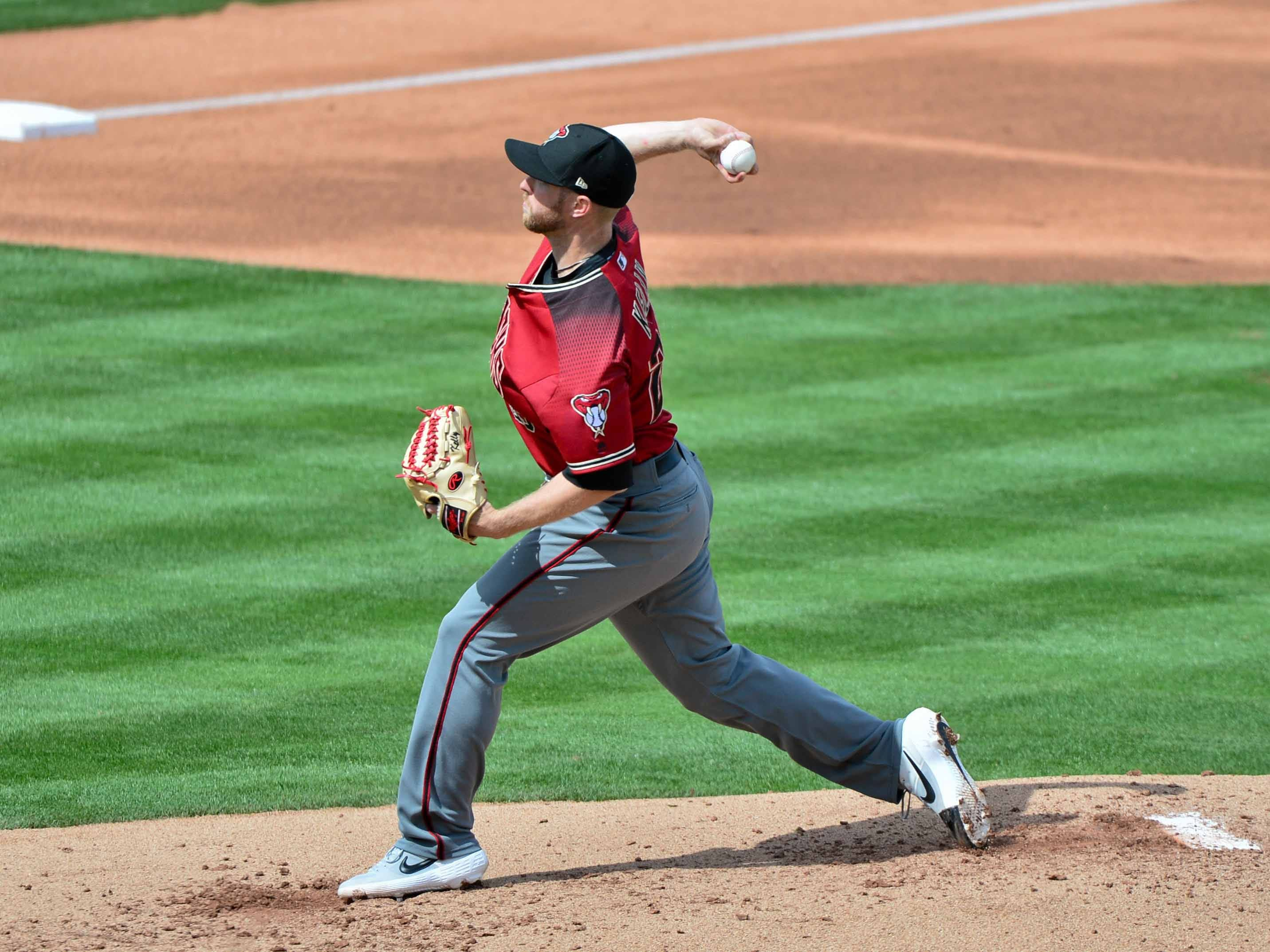 Mar 15, 2019; Tempe, AZ, USA; Arizona Diamondbacks starting pitcher Merrill Kelly (29) throws during the third inning against the Los Angeles Angels at Tempe Diablo Stadium. Mandatory Credit: Matt Kartozian-USA TODAY Sports