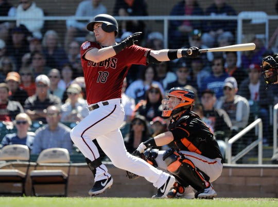 Arizona Diamondbacks' Carson Kelly in action against the San Francisco Giants in a spring training baseball game Thursday, March 14, 2019, in Scottsdale, Ariz.
