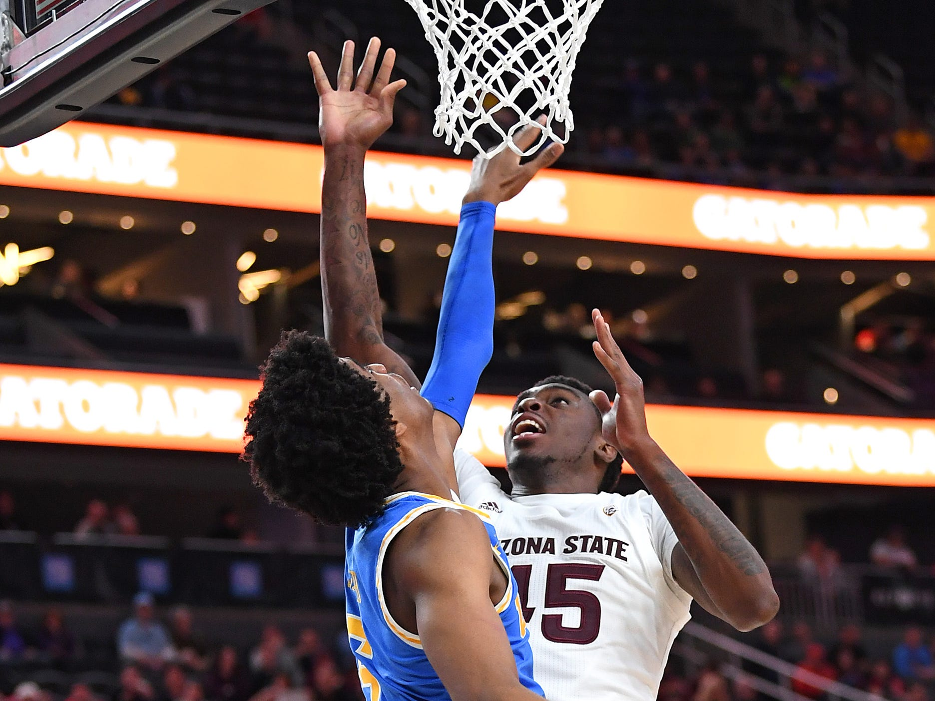 Mar 14, 2019; Las Vegas, NV, United States; Arizona State Sun Devils forward Zylan Cheatham (45) shoots against UCLA Bruins guard Chris Smith (5) during the first half of a Pac-12 conference tournament game at T-Mobile Arena.