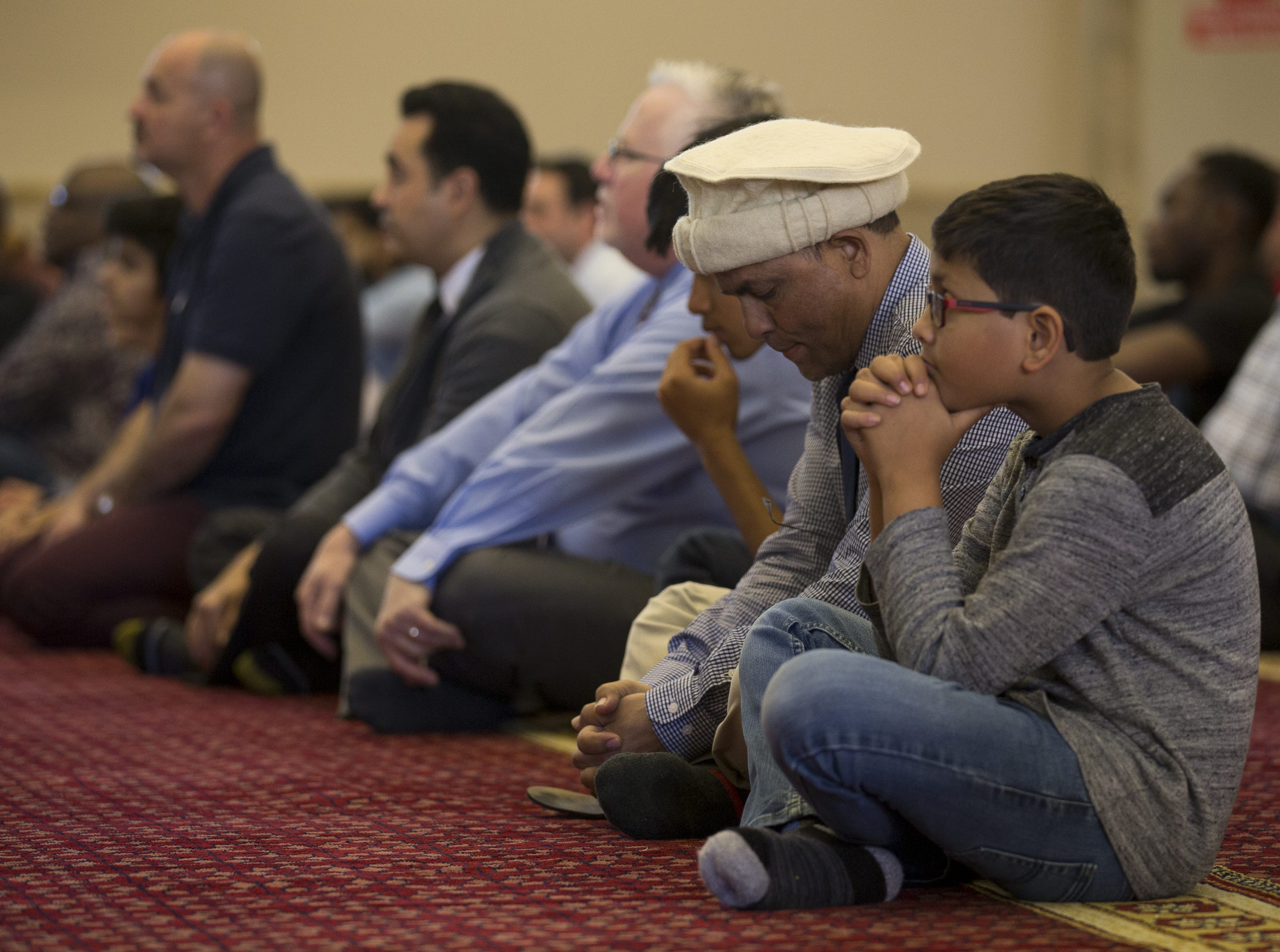 Worshippers pray at the Islamic Center of the North East Valley in Scottsdale on March 15, 2019. The prayer addressed the shooting in New Zealand, which killed 49 people worshipping at mosques.
