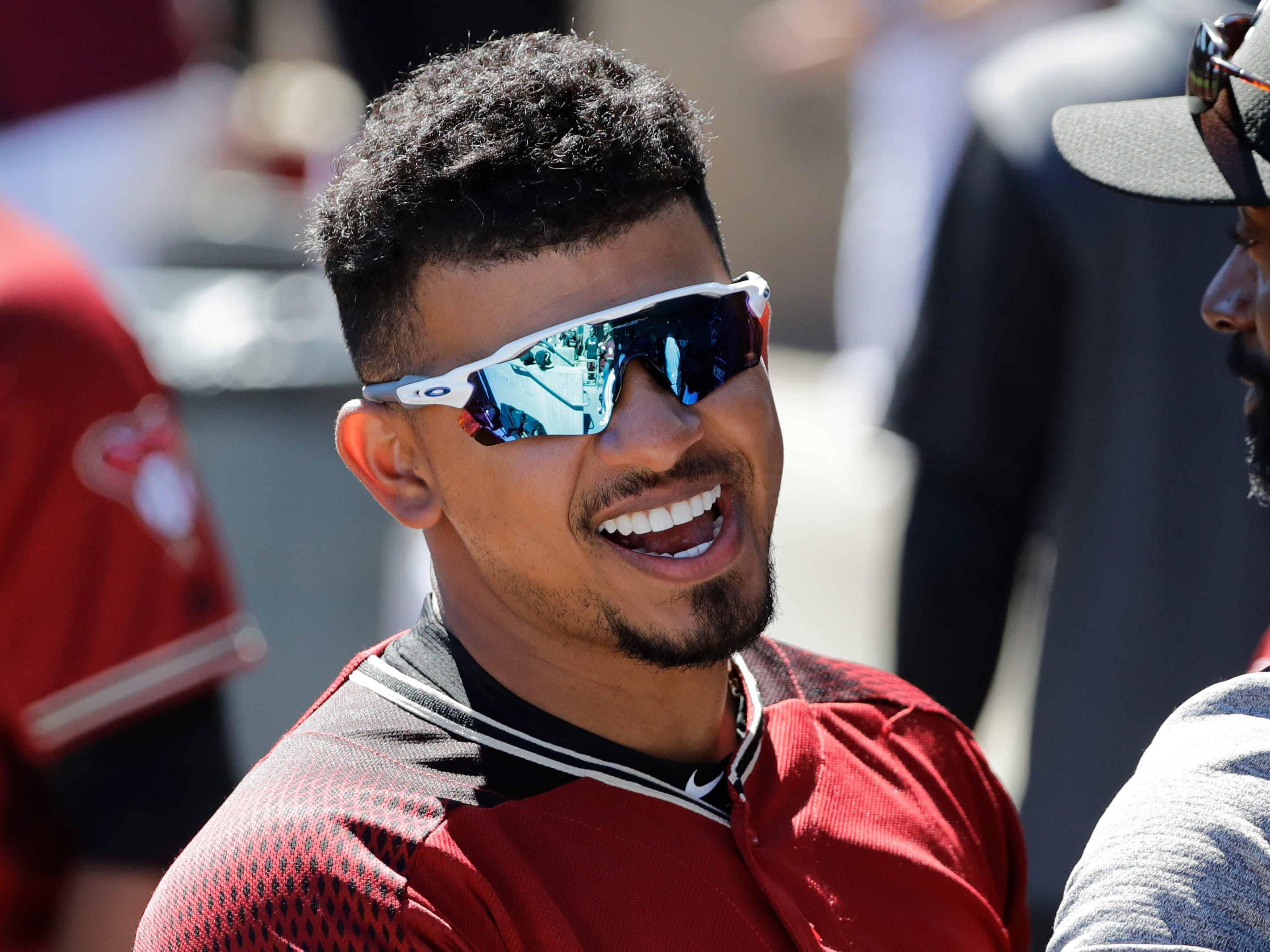 Arizona Diamondbacks' Eduardo Escobar smiles in the dugout before a spring training baseball game Thursday, March 14, 2019, in Scottsdale, Ariz.