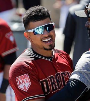 Arizona Diamondbacks' Eduardo Escobar smiles in the dugout before a spring training baseball game Thursday, March 14, 2019, in Scottsdale, Ariz.