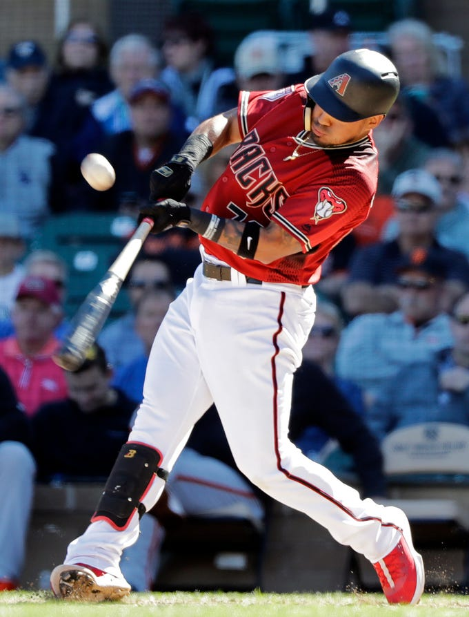 Arizona Diamondbacks' Juniel Querecuto connects on a two-run double against the San Francisco Giants in the seventh inning of a spring training baseball game Thursday, March 14, 2019, in Scottsdale, Ariz.