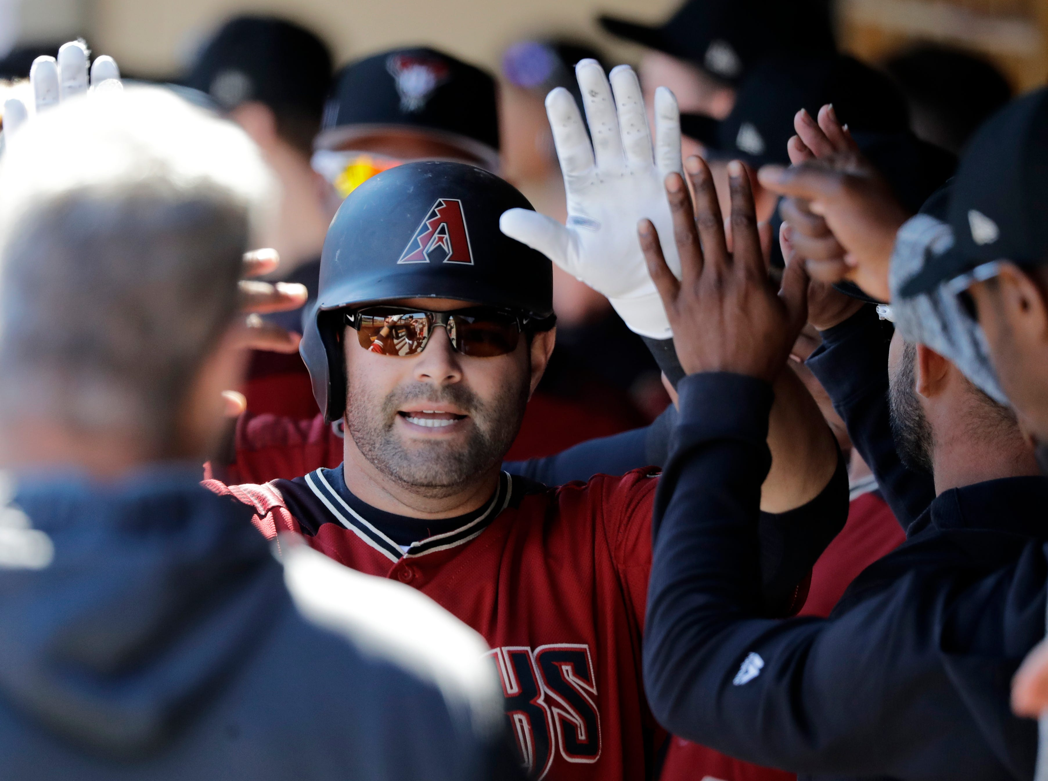 Arizona Diamondbacks' Alex Avila is congratulated after driving in a run against the San Francisco Giants in a spring training baseball game Thursday, March 14, 2019, in Scottsdale, Ariz.