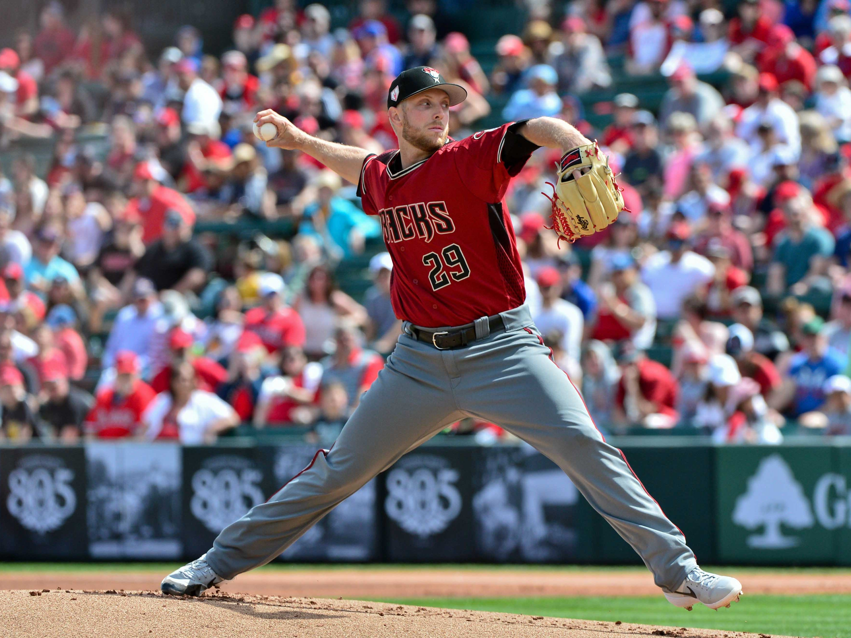 Mar 15, 2019; Tempe, AZ, USA; Arizona Diamondbacks starting pitcher Merrill Kelly (29) throws during the first inning against the Los Angeles Angels at Tempe Diablo Stadium. Mandatory Credit: Matt Kartozian-USA TODAY Sports