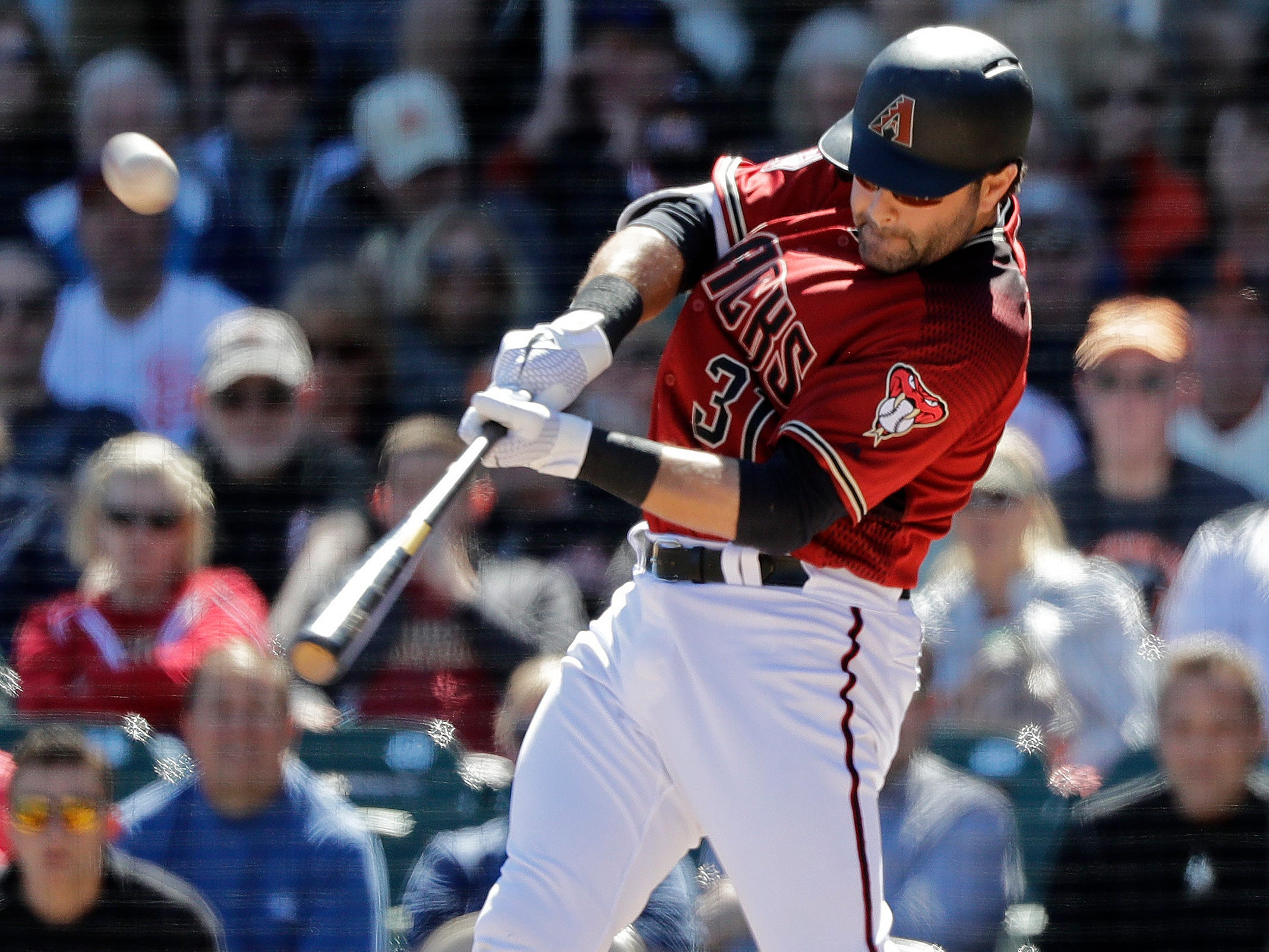 Arizona Diamondbacks' Alex Avila drives in a run with a sacrifice fly against the San Francisco Giants during the second inning of a spring training baseball game Thursday, March 14, 2019, in Scottsdale, Ariz.