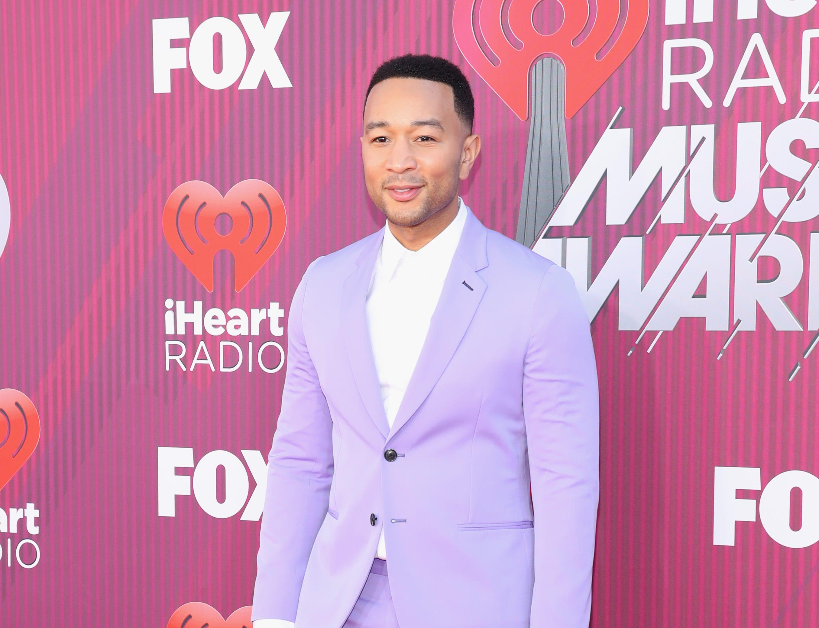 John Legend a su llegada a los premios iHeart Radio Music Awards en 2019 el 14 de marzo de 2019 en Los Angeles, California.