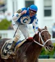 Jockey Stewart Elliott reacts aboard Smarty Jones (15), after crossing the finish line to win the Kentucky Derby at Churchill Downs, Saturday, May 1, 2004, in Louisville, Ky.(AP Photo/Ed Reinke)