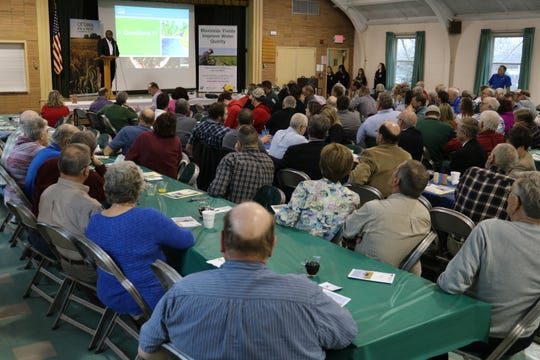 Terry Cosby, Ohio's state conservationist with the USDA, speaks to local farmers at the Ottawa SWCD's annual community breakfast in Oak Harbor on Friday.