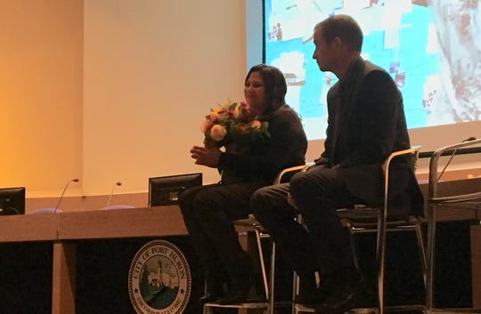 Mara McCalmon, founder of P.S. You're My Hero, and St. Clair County Prosecutor Michael Wendling talk with a group on overcoming trauma on Thursday, March 14, 2019, in Port Huron