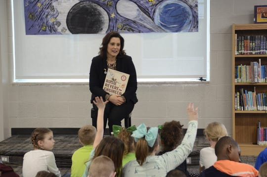 "Michigan Governor Gretchen Whitmer holds a copy of ""Rosie Revere, Engineer,"" which she read to second grade students at Port Huron's Crull Elementary School on March 15, 2019 in Port Huron, Michigan."