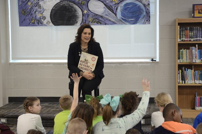 "Michigan Governor Gretchen Whitmer holds a copy of ""Rosie Revere, Engineer,"" which she read to second grade students at Port Huron's Crull Elementary School on March 15, 2019 in Port Huron. Thursday, she ordered all school buildings to remained closed for the remainder of the school year due to the coronavirus pandemic."