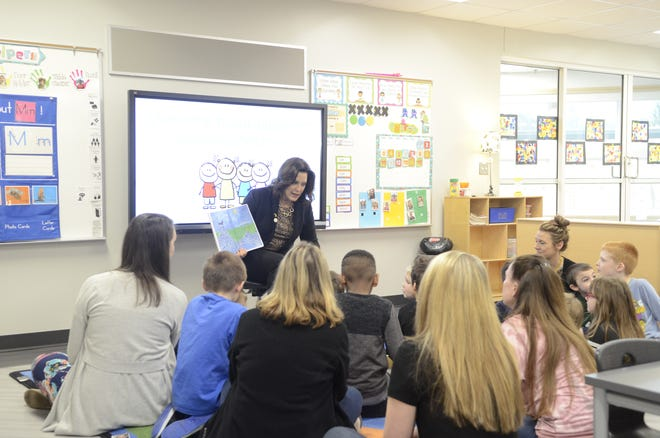 Michigan Governor Gretchen Whitmer reads to a group of students at Port Huron Area School District's Early Childhood Center during a visit on March, 15, 2019, in Port Huron, Michigan.