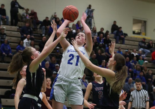 Millbrook's Erin Fox (21) goes up for a shot against Watkins Glen during the girls Class C state semifinal at Hudson Valley Community College in Troy March 15, 2019. Watkins Glen won the game 53-42.