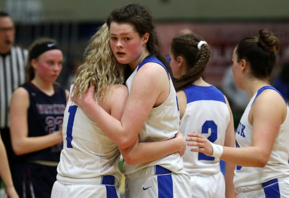 Millbrook's Erin Fox (21) hugs teammate Sam McKenna (1) after Millbrook was defeated by Watkins Glen 53-42 in the girls Class C state semifinal at Hudson Valley Community College in Troy March 15, 2019.